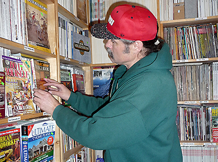 AJ Jones has worked with resale publicationsfor two decades. He keeps special issues near the cash register. The shop is lined with neatly labeled shelves holding magazines from the early 1900s to last month.(Janet Goetze)