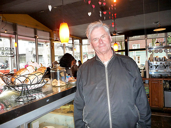 Greg Mistell, who learned baking skills from his Polish grandmother and a French baker, schedules monthly musical events in Fleur De Lis Bakery & Cafe. He plans more evening events to cater to families and the Hollywood area's senior population. (Janet Goetze)