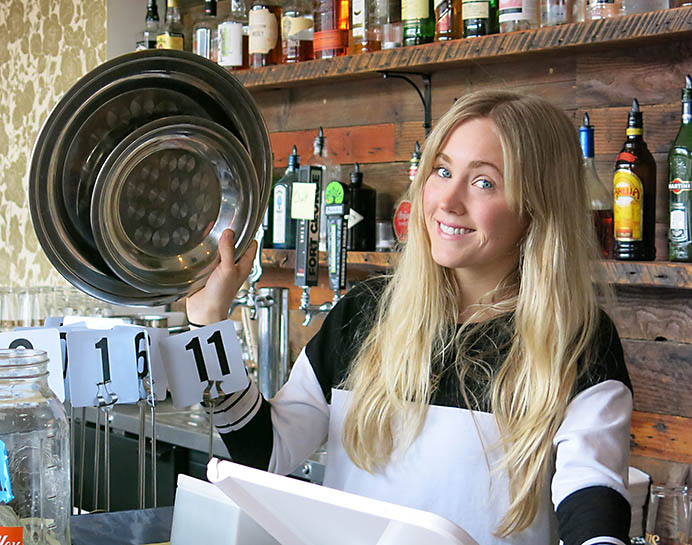 Mattie Krall, an employee of The Sudra stands ready to take customer orders for vegetarian Indian plates including calabacitas kofta, chickpea cutlet or pakora. In addition to beer and wine,  the restaurant offers specialty drinks, including cucumber vodka and blueberry gin.