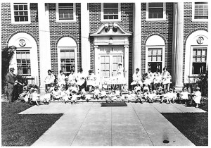Group photo with Superintendent, 10 women and 49 infants andtoddlers on the front steps of Albertina Kerr Nursery, c. 1941. (Courtesy of Albertina Kerr's archives)