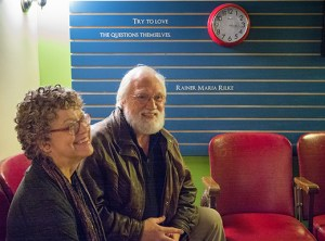 Lynne Joy and Roger Nesbit sit on old movie seats she found on Craig's List to furnish the lobby of Wise Counsel and Comfort's office at the North Williams location.