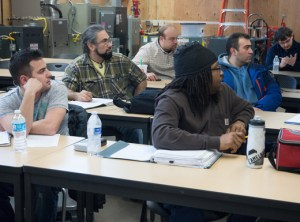 Students attend a Vocational English as a Second Language class in a HVAC installation and repair certificate program, part of Portland Community College's Swan Island Trades Center.