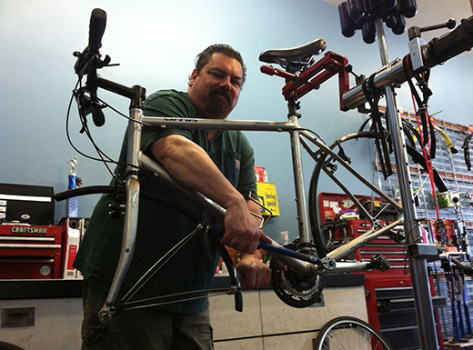 Missing Link Bicycle Shop mechanic Steve Johnson works on a bike at the shop's original location in Northeast Portland's Roseway neighborhood. (Jane Perkins)
