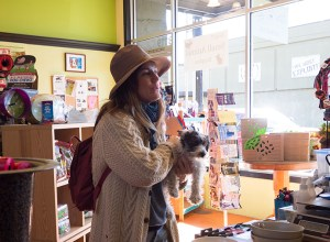 Maven Collective co-owner Jacklyn Arvin shops for pet supplies for her new puppy, Felix, at Personal Beast Pet Store. Both shops are located on Southeast Stark Street.