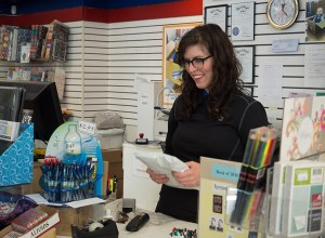 Whitney Hoffman started working at Postal Annex on Northeast Broadway during the busy holiday shopping season in 2014.