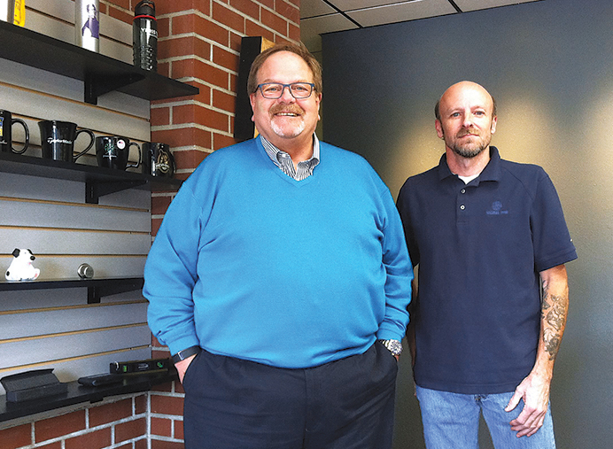 Morel Ink co-owner Bill Dickey and Morel Quick! manager Scott Piel in the company's new retail space. (Ted Perkins)