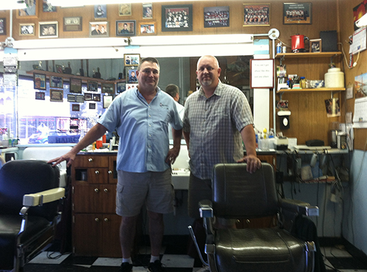 Roseway Barber Shop owner Marty Pinz, left, and Roby Hunt offer traditional crew cuts and flattop styles. Marty's father, Joe Pinz first purchased the shop in 1956. (Jane Perkins)
