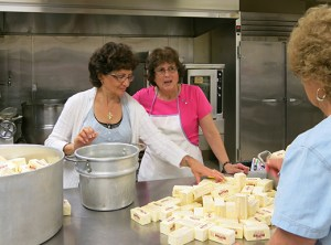 Volunteers unwrap pounds of organic butter for use in Greek pastries and cookies for the annual Portland Greek Festival. Recipes are traditionally prepared, items are baked and ultimately packaged in the annex building across from Holy Trinity Greek Cathedral on Northeast Glisan Street.