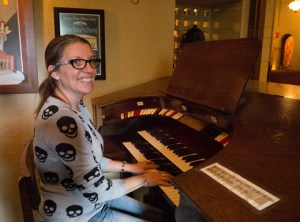 Chapel Pub manager Adrianne Wilson sits at the organ inside the renovated Chapel of the Chimes mortuary. The original organ, moved from Seaside's Strand Theatre in 1932, is still operational today with an organist taking song requests from pub patrons on Thursday nights.