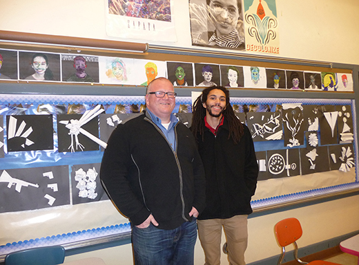 "Eighth-grade social studies teacher Donald Rose, left, and Jayme Causey, former pupil now a student teacher, incorporate art assignments in U.S. history class. Behind them are students' sculptural interpretations of ""revolution"" in black and white paper. (Janet Goetze)"