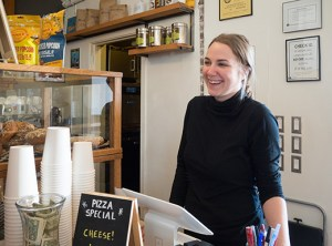 Karina Briski enjoys serving customers at Marthas, located inside the former Washington High School's southwest corner. Marthas opened in September 2015, offering meals daily and revolutionary happy hour deals from 4-6 p.m. The cafe is also open evenings for patrons attending Revolution Hall events. (Judy Nelson)