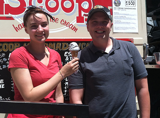 Olivia Niosi, left, and Sean Sitton offer up one of their signature flavors, PDX Carpet, at Scoop Handmade Ice Cream – which opened this month at the 42nd Avenue Food Cart in the Concordia neighborhood. (Jane Perkins)