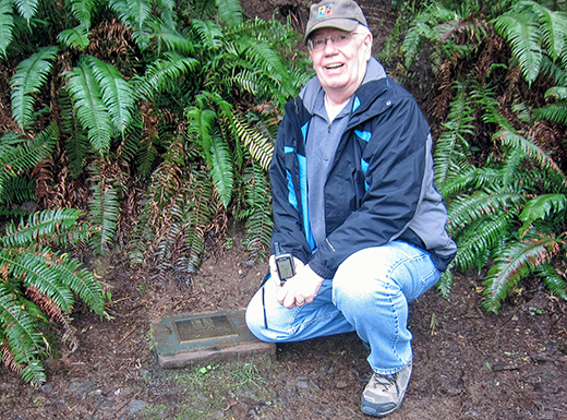 "John Butenschoen at the site of the birth of geocaching near Estacada, Oregon. The first cache was called a ""stash."" Geocachers have been known to make pilgrimages to this site. (John Butenschoen)"