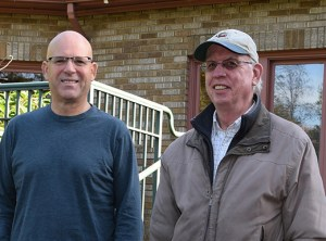 Greg Dufour, chair of the non-profit Friends of Overlook House and Alan Cranna, vice chair of the Overlook Neighborhood Association, overlook the beautiful grounds behind the historic Overlook House. The house is available for rentals for events ranging from weddings to funerals, birthday parties and graduations.
