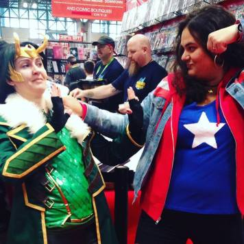 Saturday: Miss America Chavez from Young Avengers. I was so happy I found this awesome Kid Loki cosplayer that was totally into letting me menace her for a photo.