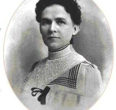 Black and white head and shoulders photographic portrait of Haskell, dress and hairstyle of late 19th century