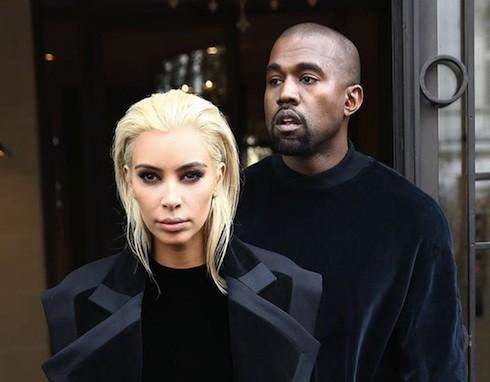 Kim Kardashian and Kanye West leaving their hotel