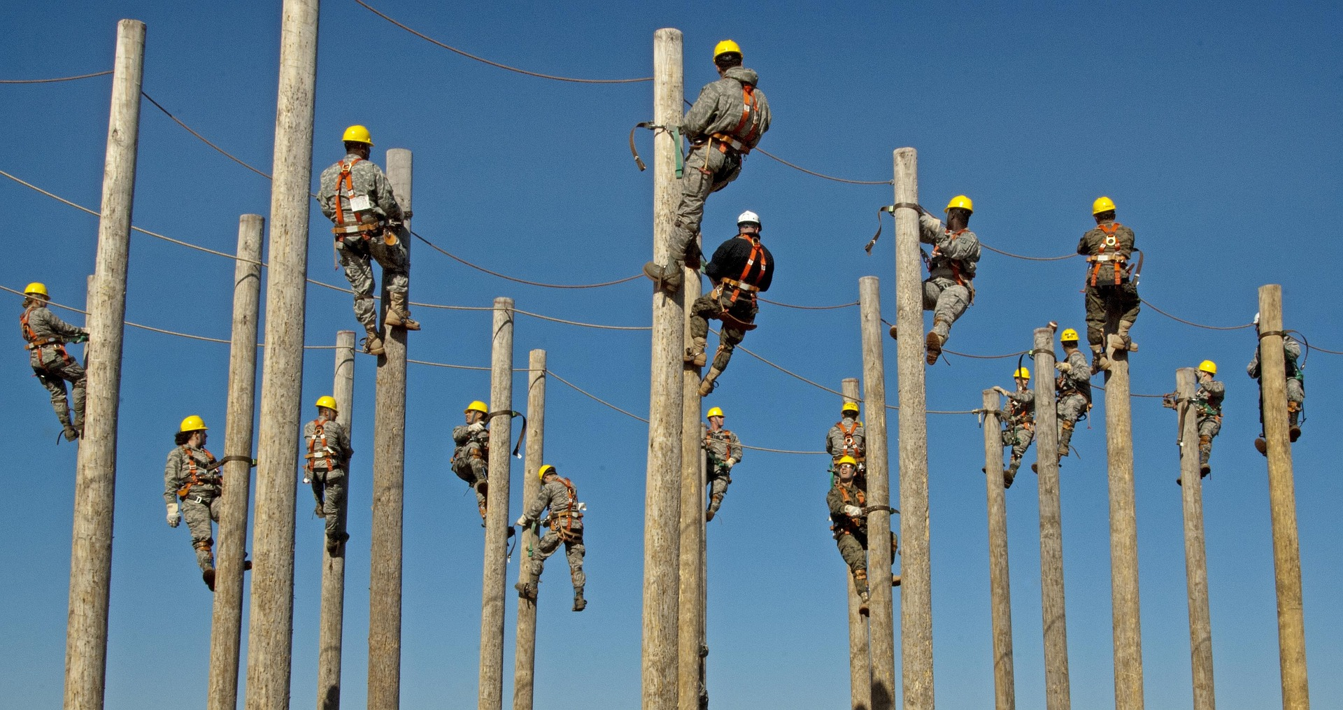 workers training to climb telegraph pole