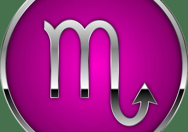 scorpio glyph on magenta background