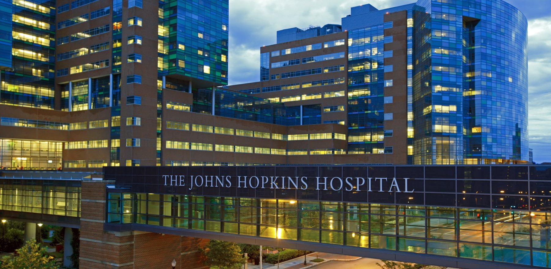 BALTIMORE - JUNE 28: The Johns Hopkins Hospital at night from Orleans Street on June 28, 2015 in Baltimore, Maryland. The Johns Hopkins Hospital is a teaching hospital and biomedical research facility.