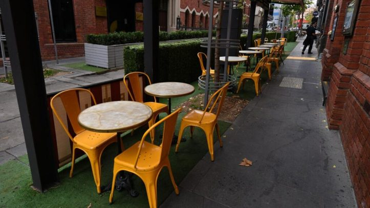 Empty seats at a cafe in Melbourne as the city's lockdown continues.