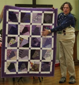 Bobbi Badger - Comfort quilt. Made using the purple crazy pieced blocks she won, made by members.
