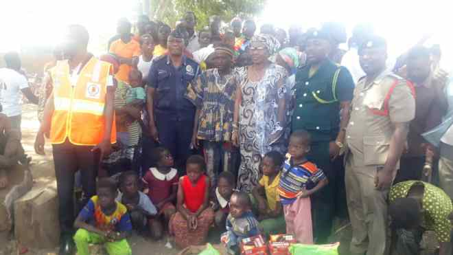 The District Chief Executive of Bawku West, Victoria Ayamba, and security commanders visit the refugees at Widnaba