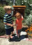 Hank and Becket at Little Free Library