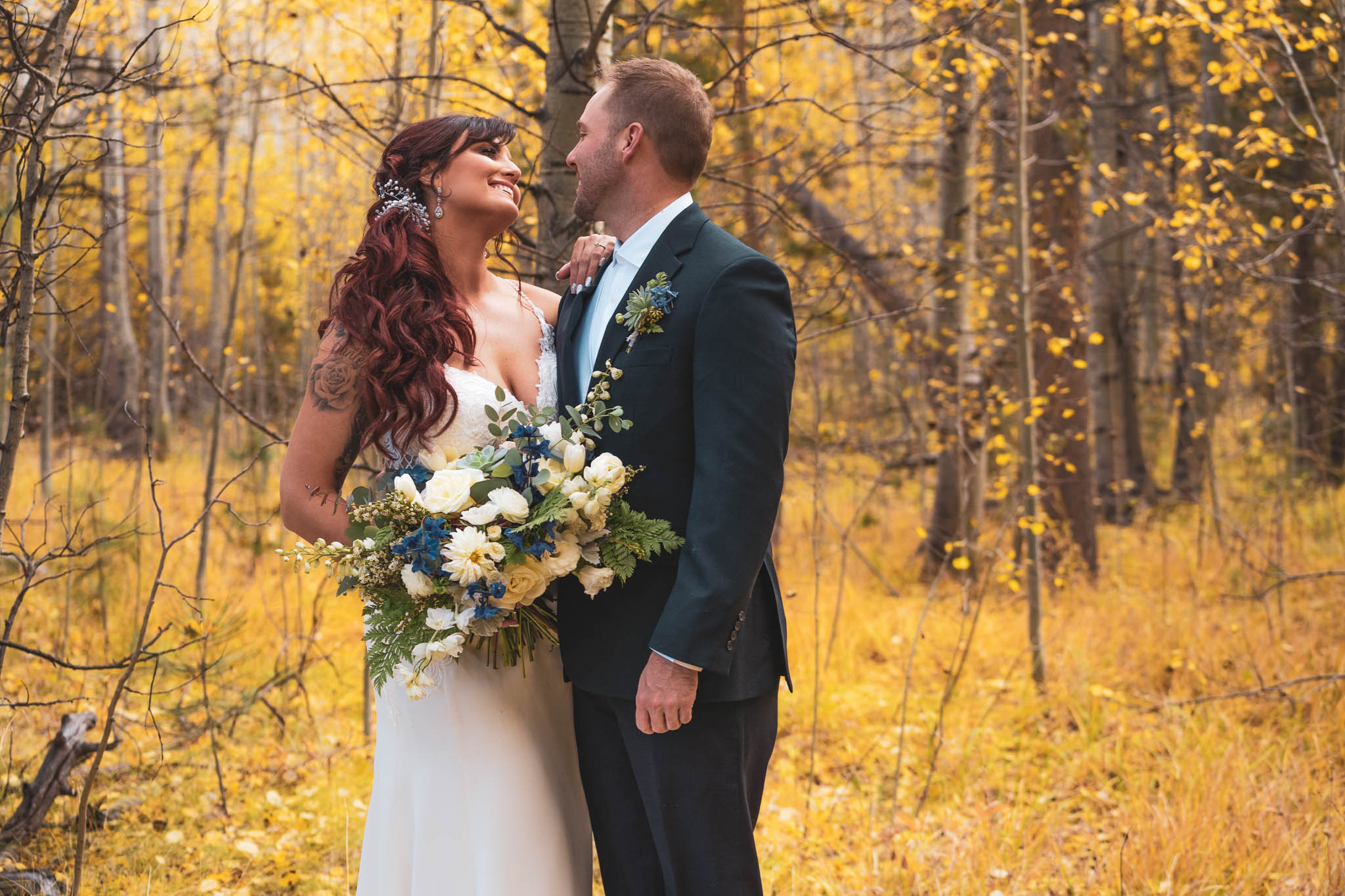 Lake Tahoe wedding packages featuring couple in aspen trees