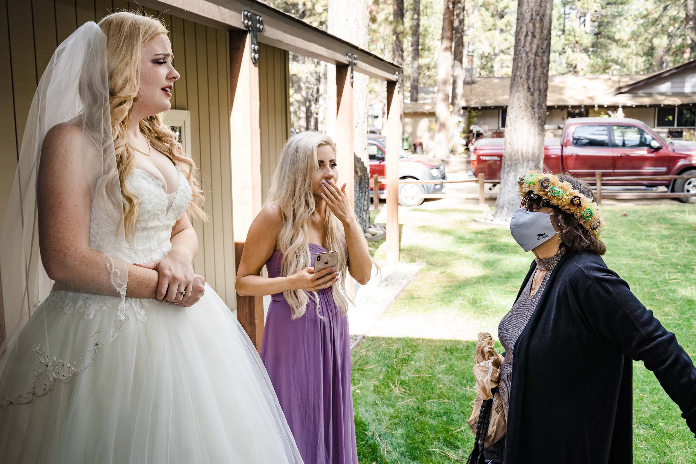 Bride meeting with her grandmother outside with a mask during a Covid wedding