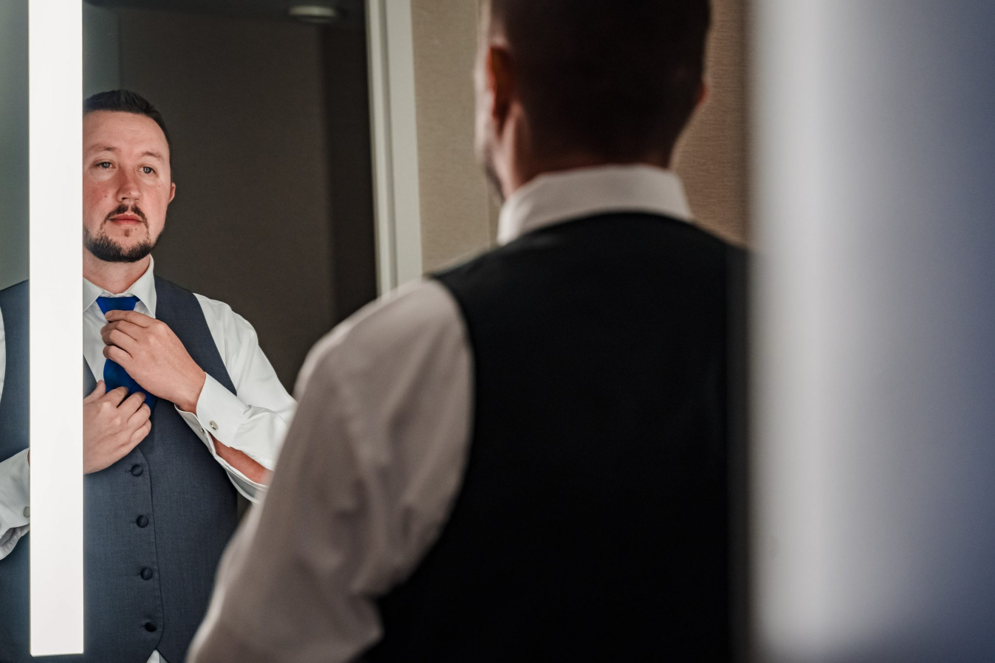 Groom getting ready at Harveys Harrahs wedding in South Lake Tahoe