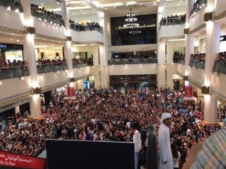 4. As early as day prior, fans trooped to the Khalidiya Mall to honor th...