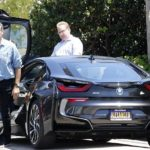 Pierce Brosnan coming out of his car BMW i8