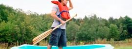 Man in a row boat in a field - Thinkstock