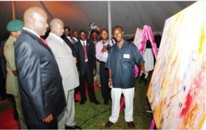 L-R, HE Pierre Nkurunziza, HE Y. K. Museveni and Roland Birutsya