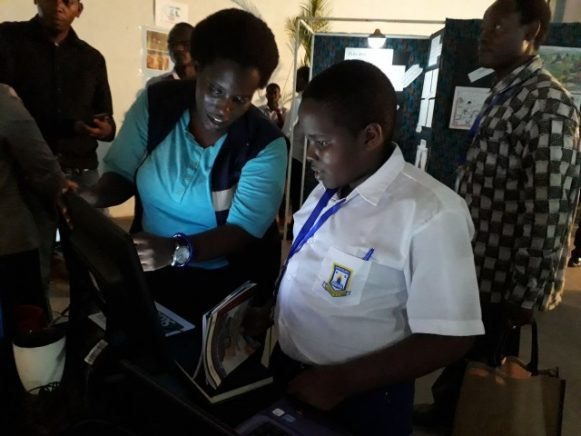 Rachael Kangumba from Leaves Art and Animation studio shows a new animated character to a pupil.