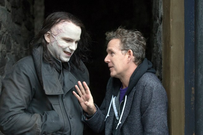 "In this photo provided by Showtime, Rory Kinear, left, as the creature, speaks with John Logan on the set of the television series, ""Penny Dreadful."" Season 2 makes its debut on Showtime Sunday night, May 3, 2015. (Jonathan Hession/Showtime via AP)"