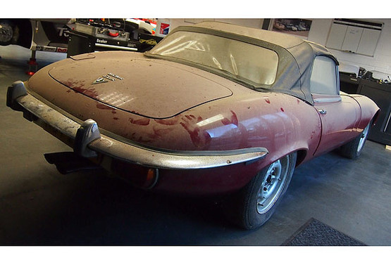 A dust-covered Jaguar E-Type which has been hidden away for more than 25 years is expected to sell for £90,000 at auction.See swns story SWJAGUAR. The 1973 Jaguar E-Type Series III V12 Manual Roadster has been owned by the same family its entire life.But it has hardly been used and has been off the road for a quarter of a century - with the 1990 tax disc still stuck on the windscreen.In 1993, the original owner gave it to his son, who kept it garaged before it was passed onto the owner's son following his death last year.And despite being more than 40 years old, the convertible has been driven just 7,700 miles in its lifetime.The current owner, who is the grandson of the man who bought the Jag, has now decided to sell it through Silverstone Auctions on May 23.