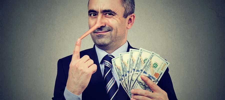Wirtschaftsbetrüger (Bild: Shutterstock)