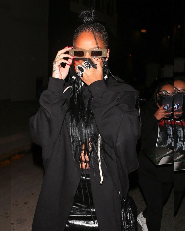 Rihanna steps out in all black look worth over Rs. 1.5 lakhs; dons tiny mini skirt and duster overcoat following midriff flossing trend : Bollywood News Moviesflix - MoviesFlix | Movies Flix - moviesflixpro.org, moviesflix , moviesflix pro, movies flix