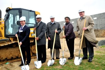 Posing with ceremonial shovels at the Dermody groundbreaking are, from left: Dermody president Doug Kiersley, Logan Township Mayor Frank Minor; Joseph Veraggi from Great Point Investors; Bernadine Jackson, deputy mayor; and Gene Preston of Dermody. (Steve Lubetkin photo.)