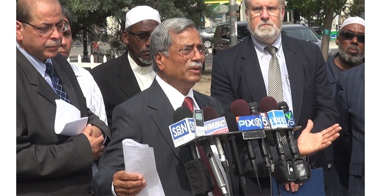 Members of the New Jersey Muslim Community look on as Mohammed Ali Chaudry, president of the Islamic Society of Basking Ridge, NJ, makes remarks at a press conference held to describe the Muslim community's response to the arrest of Ahmad Khan Rahami in connection with the placement of bombs in New Jersey and New York.