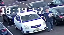 Frame capture from surveillance video released by Evesham Township Police shows a man alleged to be distributing anti-Semitic flyers on cars parked in the Burlington County municipality. The man was seen on two occasions distributing the anti-Jewish flyers, police said.
