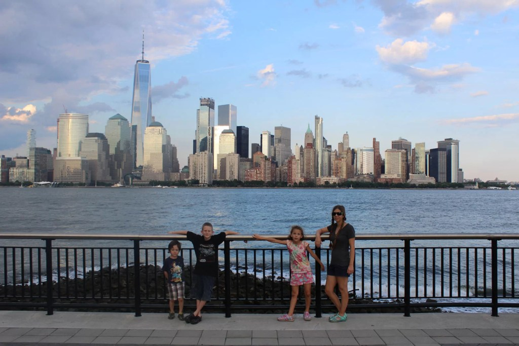 A Family in Front of New York City. Planning a Family Vacation: 10 Tips for Selecting a Destination