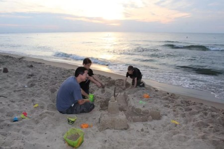 Family playing with beach toys