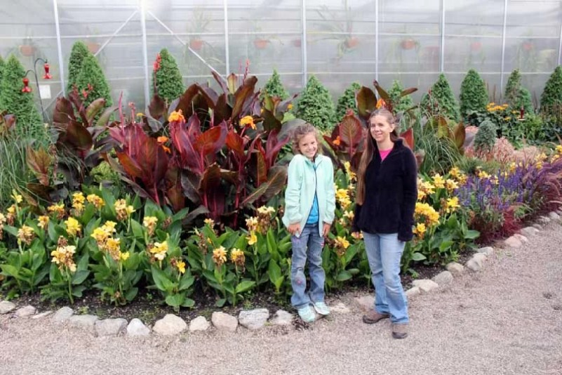Why You Should Visit the International Peace Gardens, two girls standing in the garden