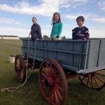 3 kids in a wagon