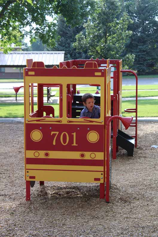 Trip in a fire truck play structure
