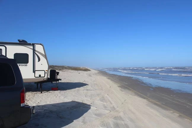 A travel trailer at the beach