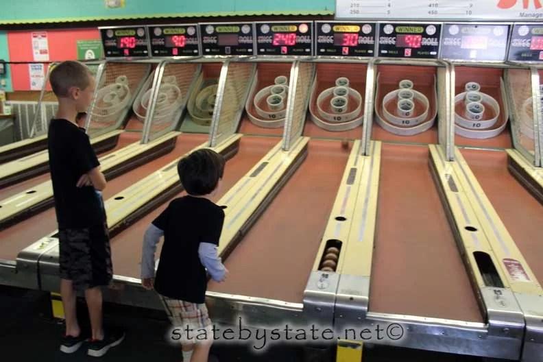 Boys playing at an arcade
